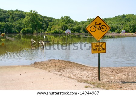 Signs and a flooded basketball court are remnant of the flood waters that hit the U.S. - stock photo