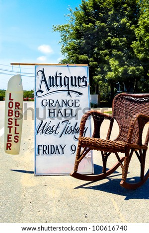 Signs for summer antique sale and lobster rolls in Martha's Vineyard, Massachusetts, USA - stock photo