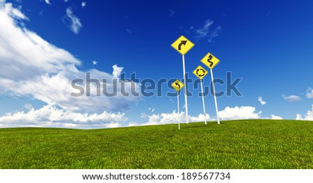 Signs in a meadow with blue sky
