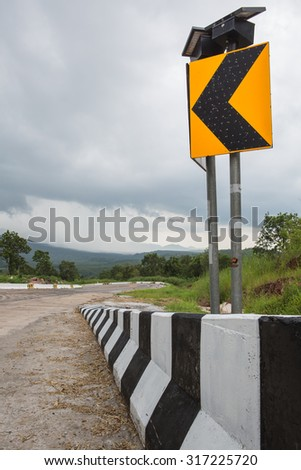 Signs installed on the curved road is dangerous and can drive down the street to install . To remind , at night The system has a built-in sensor to turn - turn off at night . And use of solar energy - stock photo