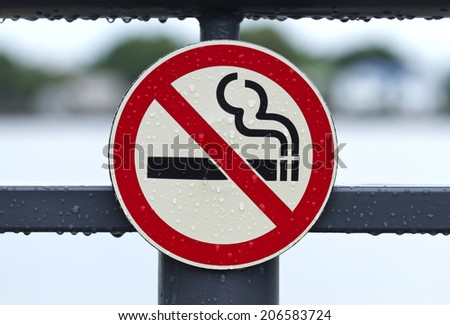 Signs no smoking on the sidewalk - stock photo