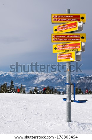 Signs of slope and chairlifts  directions in ski resort Elmmau Austria :  Slopes 64-68 right, slopes 71,74 to Soil village left, slopes 60-62,66 right, slopes 70,71 to Going village left.