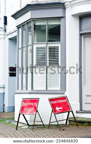 Signs on a city pavement stating footpath is closed - stock photo
