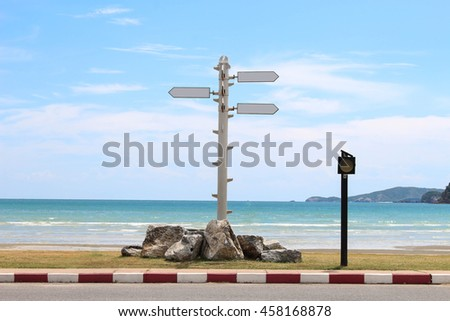 Signs on the beach, choose a travel destination. - stock photo