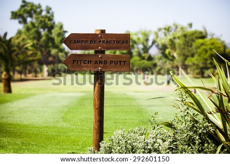 Signs post at golf course in Spain. - stock photo