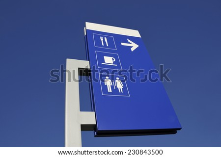 Signs to restaurant and toilets alongside a French highway - stock photo