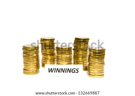 signs with winnings  in front of golden coin piles