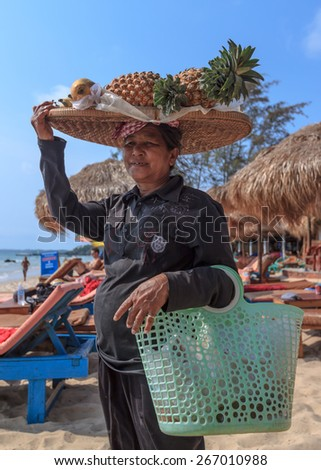 SIHANOUKVILLE, CAMBODIA -  MARCH 03, 2015: unidentified woman selling fresh fruit at the shoreline