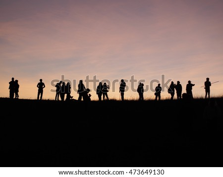 sihouettes group of people watching sunset on top of mountain, Doi Mon Jong, Chiangmai, Thailand