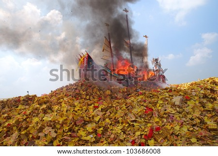 SIKANG, TAIWAN-MAY 7: The Burning King Boat Ceremony in Sikang, Taiwan on May 7, 2012. It is one of the oldest religious ceremonies in Taiwan and held every three years. - stock photo