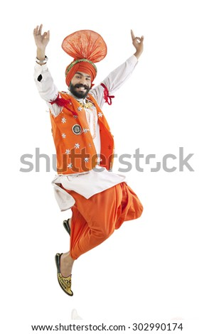 Sikh man jumping in the air - stock photo