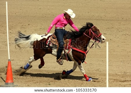 SIKLUV MLYN, CZECH REPUBLIC - AUGUST 13: Unidentified rider competes at the Czech Republic Championship Rodeo Show 2011 on August 13, 2011 in Sikluv Mlyn, Czech Republic - stock photo