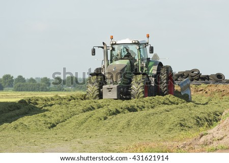 silage with a large tractor - stock photo