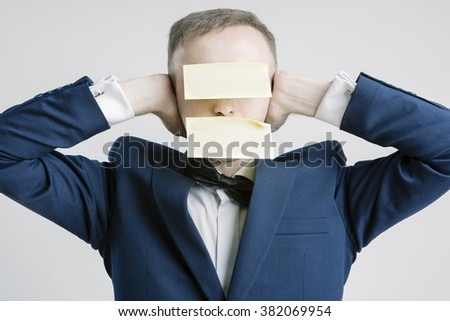 Silence and Secrets Concepts And Ideas. Portrait of Caucasian Businessman With Paper Sticker on Forehead and Mouth. Hands Closing Ears.Horizontal Image - stock photo