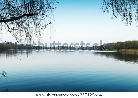 Silent coastal landscape. West Lake park in Hangzhou city center, China
