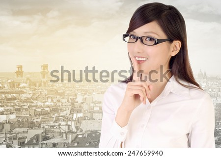 Silent gesture by businesswoman with smile. - stock photo