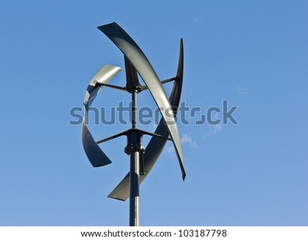 Silent urban styled wind turbine with blue sky. - stock photo