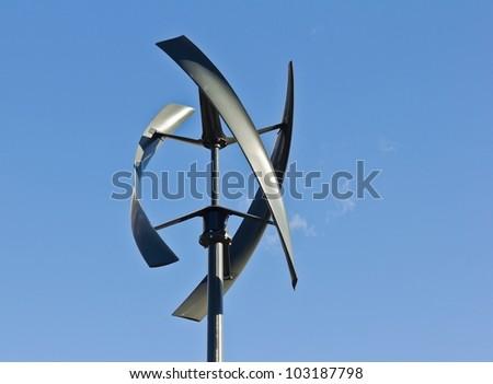 Silent urban styled wind turbine with blue sky. - stock photo