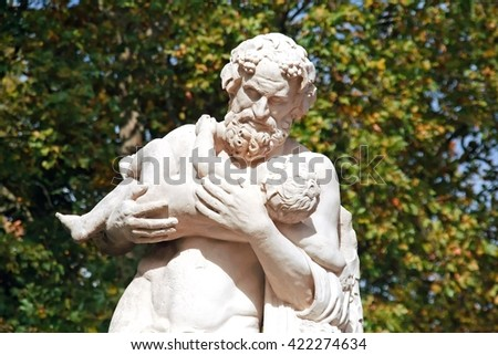 Silenus with Dionysus, old antique statue. paternal love of a man for a child.