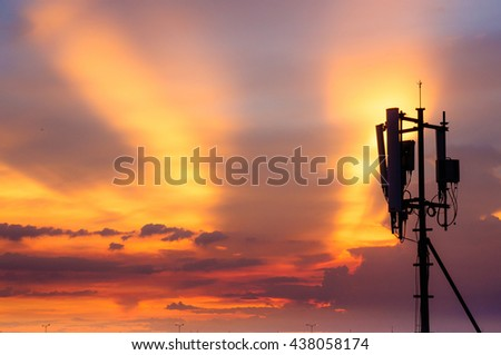silhouatte communication towers on sunset day.