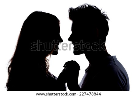 Silhouette a happy couple holding each other - stock photo