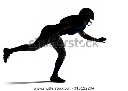Silhouette American football player jumping against white background