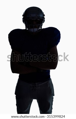 Silhouette American football player standing against white background