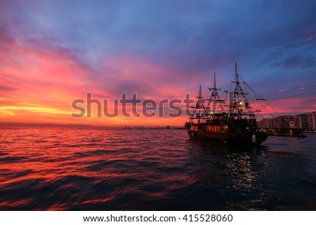 Silhouette an antique ship at a beautiful sunset. Soft focus