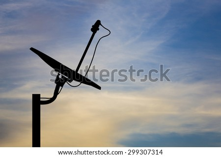 Silhouette and outline of satellite dish against the sky