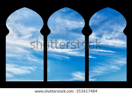 Silhouette arches inside the building of the mosque against the sky