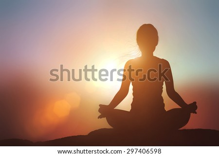 Silhouette Asia woman with Tree Pose yoga on the mountain at pastel sunset backgroun - stock photo