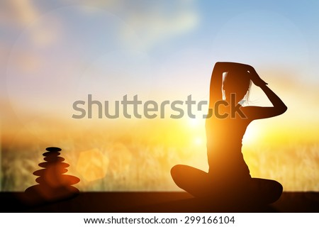 Silhouette Asia woman yoga on the beach at sunset. - stock photo