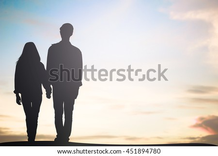 silhouette asian man woman lover couple walking together:black shadow loving people holding hand:holiday:beauty landscape:love and valentines concept:matrimonial amour affection wedding anniversary - stock photo