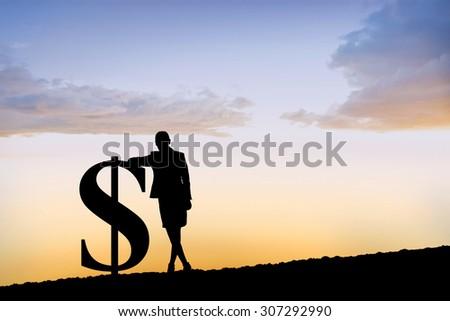 Silhouette beside dollar symbol against sun shining - stock photo