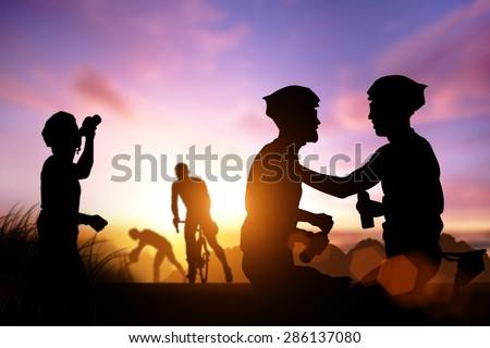 Silhouette bike on sunset,Friendship in bike sport .for poster .for banner .for advertising . for background - stock photo