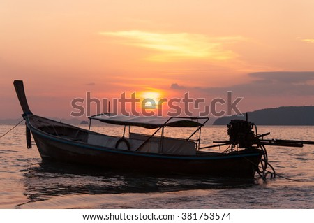 silhouette boat and tourist for journey to island trips - stock photo