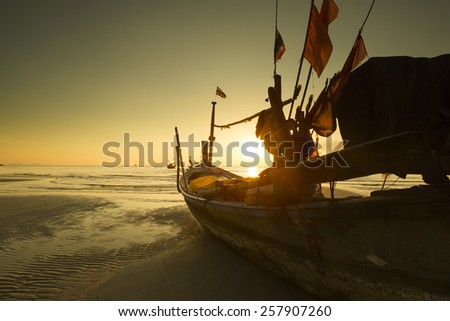 Silhouette boat when sunset time on the beach at Koh Samui, Thailand - stock photo