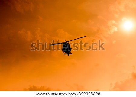 Silhouette Brave soldiers operating out assault by soldiers rappelling from a helicopter