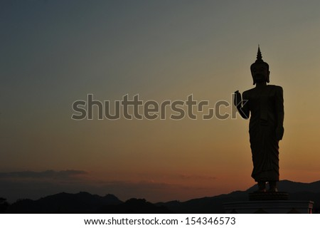 Silhouette buddha statue in sunset