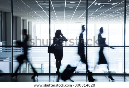 Silhouette business people walking on the background of the large windows