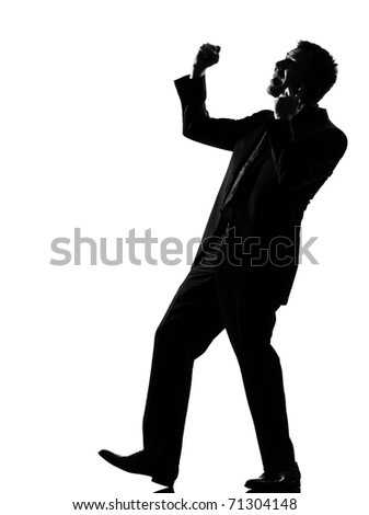 silhouette caucasian business man  expressing winning on the phone behavior full length on studio isolated white background