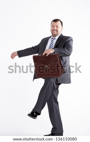 silhouette caucasian business man expressing winning winner energy success full length on studio isolated white background