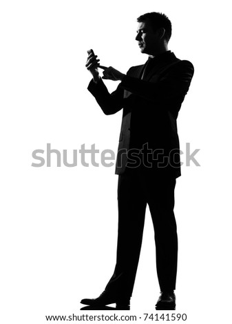 silhouette caucasian business man on the phone  sms text messaging full length on studio isolated white background - stock photo
