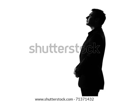 silhouette caucasian business man   profile serious looking up expressing behavior full length on studio isolated white background - stock photo