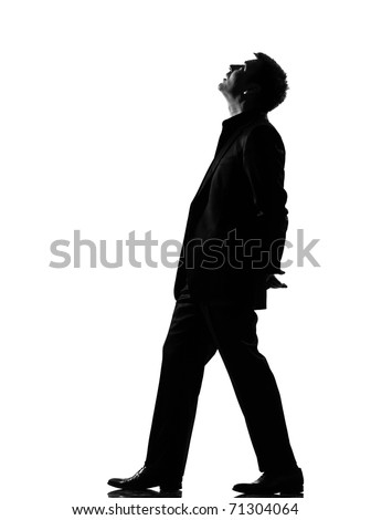silhouette caucasian business man  walking musing looking up expressing behavior full length on studio isolated white background - stock photo