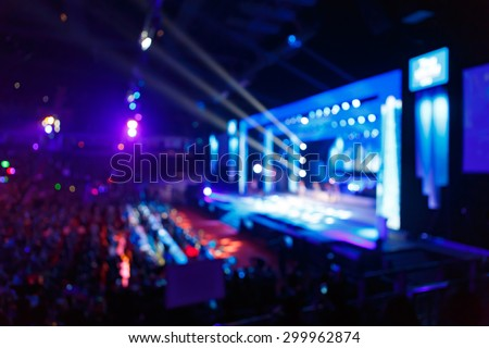 silhouette concert in front of stage - stock photo