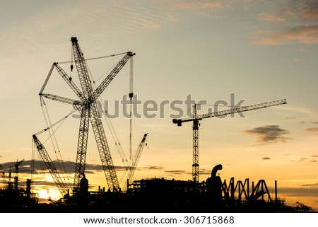 silhouette construction Industry oil rig refinery working site, asia in Thailand - stock photo