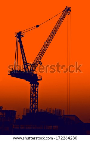 silhouette construction site - industry crane machine project sunset engineering job