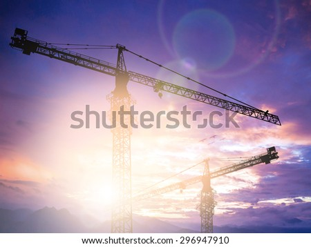 Silhouette construction site with crane. - stock photo