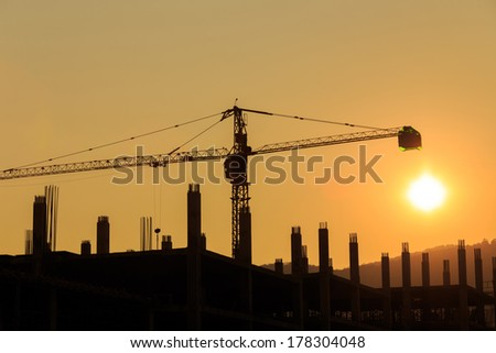 silhouette Construction Site with crane on sunset - stock photo